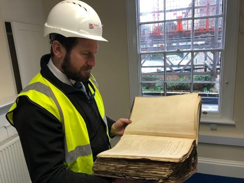 Nigel Stephens looking at the old bank ledger